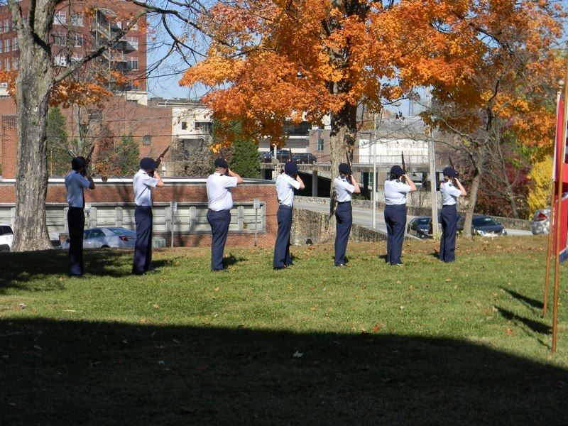 Seven cadets in uniform aim away with firearms